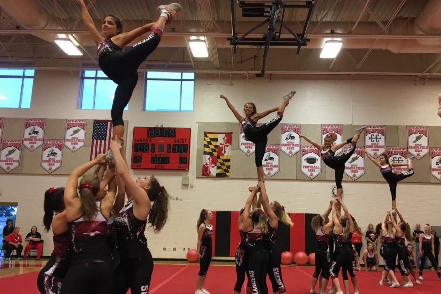 The Varsity cheerleaders perform at the pep rally.