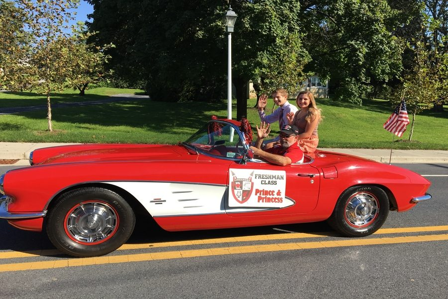 Freshman prince and princess Daniel Etherton and Lindsey Bruscia ride in style with FCPS bus drive Jeff Maley and his red car.