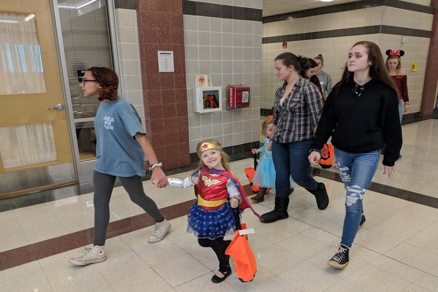 Taylor Eason, Brielynn (Wonder Woman), and other students go to the guidance office for trick or treating
