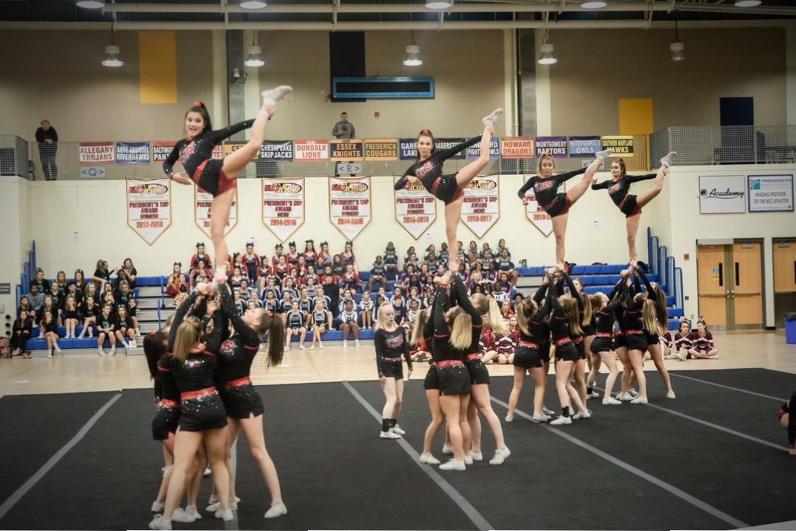 Varsity hits their stunts at Regionals.