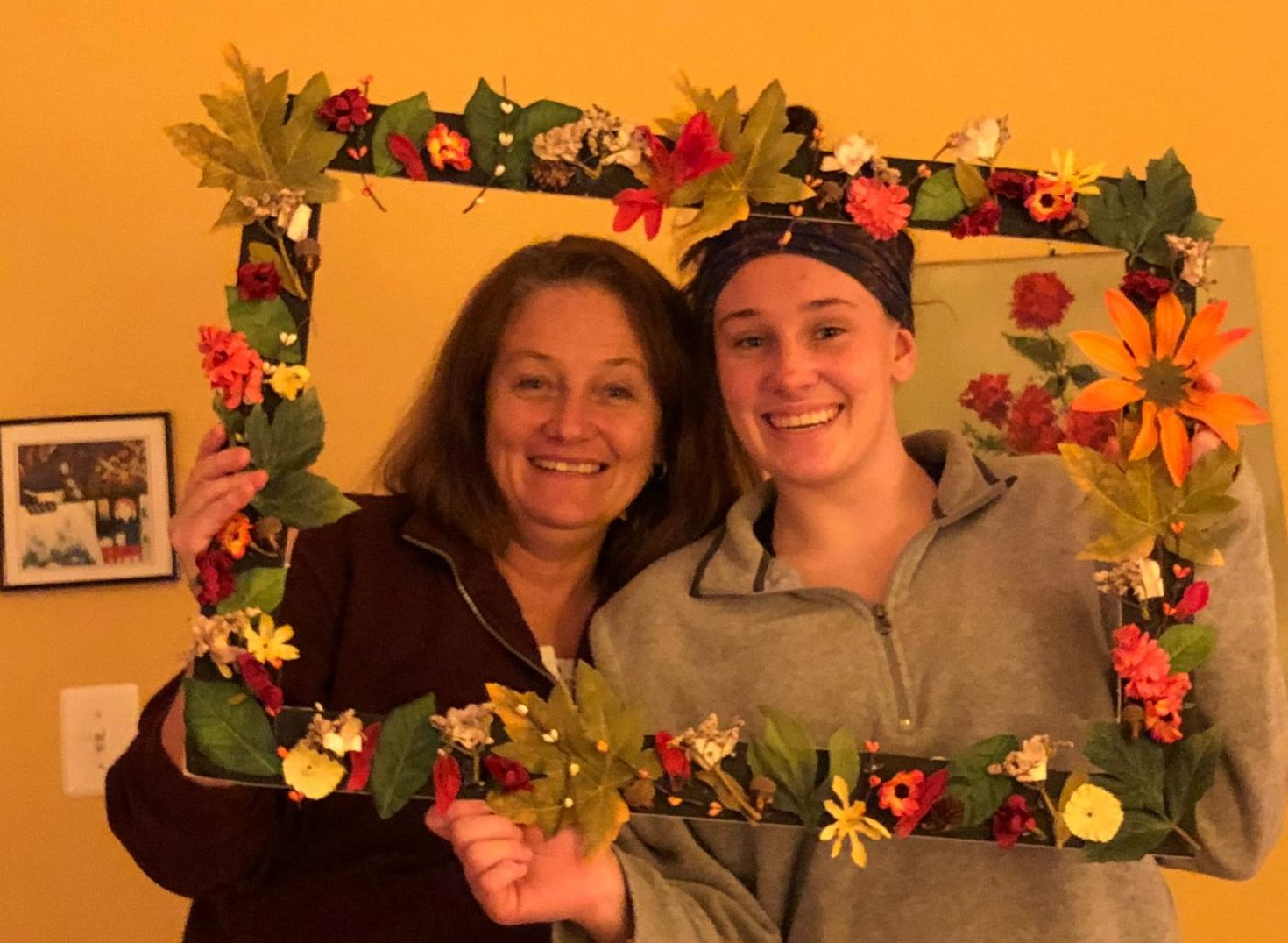 Katie Roach and her mom, Susan Roach, pose with a festive picture frame.