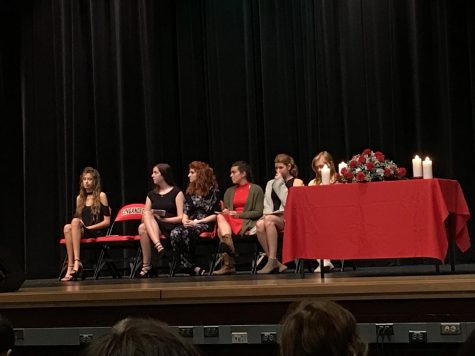 NHS officers wait to speak. From the left: Caroline Etherton, Kaley Henyon, Shelby Tkacik, Savannah Sitler, Emily Wolfe, and Jane Quackenbush.
