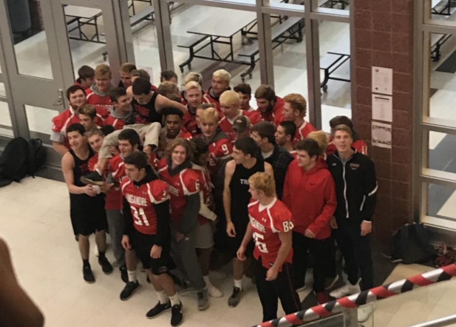 The Linganore football team watches the band perform before states.