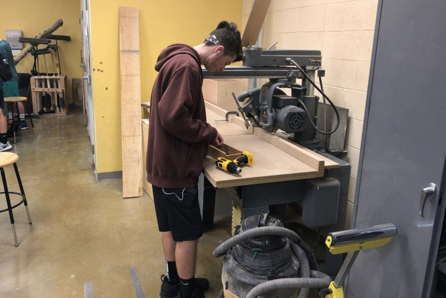 Sophomore+Tyler+Lee+works+on+a+project+in+Woodworking.