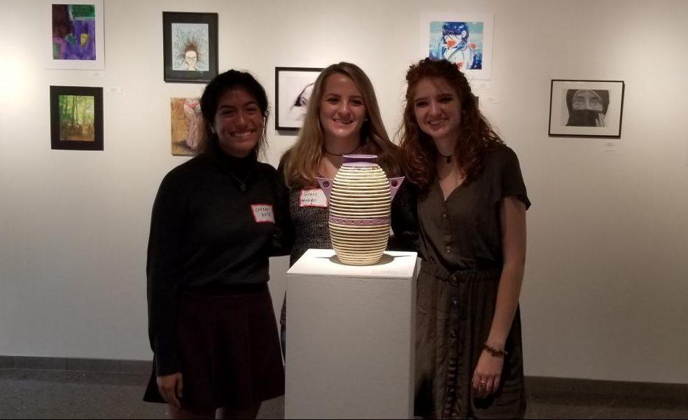 Colleen Avila, Grace Winpigler, and Shelby Tkacik posing with Winpiglers winning piece.