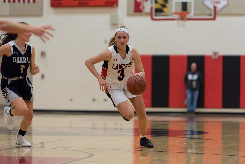 Fiona Rowan drives down the court on a fast break.