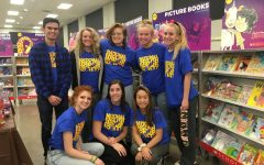NEHS members shop for families at the Scholastic Book Fair: Photo of the Day 12/6/18