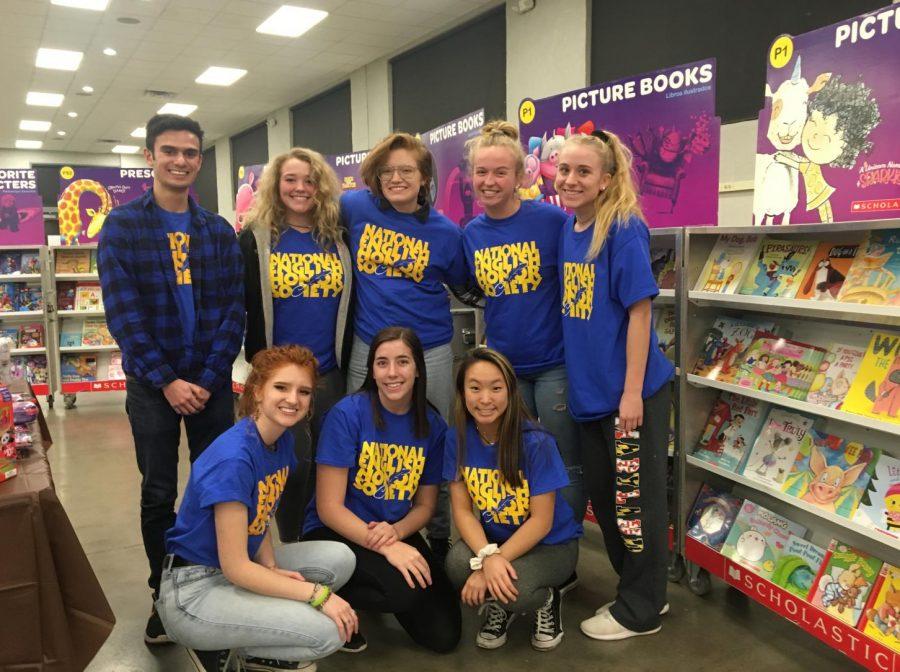 NEHS members pose at the Scholastic Book Fair in Frederick