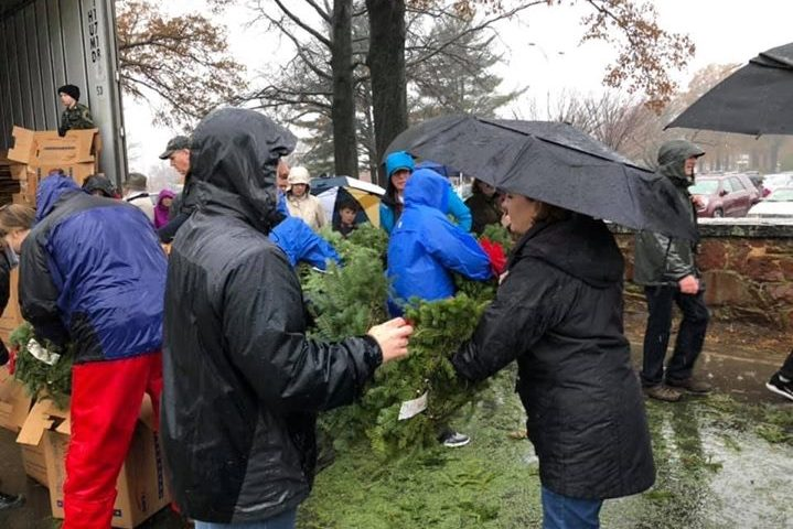 Wreaths are distributed to volunteers who place them on the graves at Arlington National Cemetery.