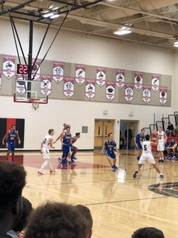 Varsity basketball surges past Lions: Photo of the Day 12/8/18
