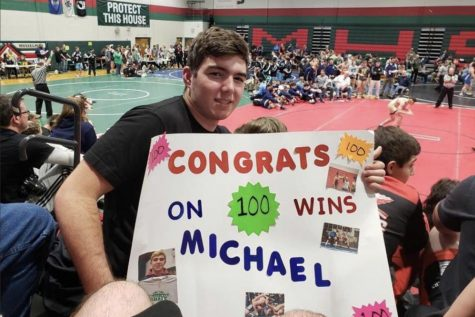 Michael Bromley celebrating his 100th win