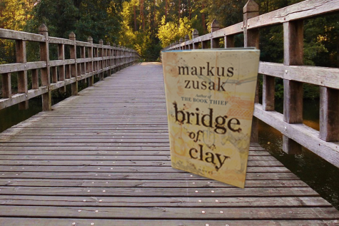 "Markus Zusak's ""Bridge of Clay"" approaches loss in a masterful blend of past and present"