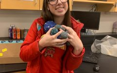 Madison Baker holds all the moons from her project