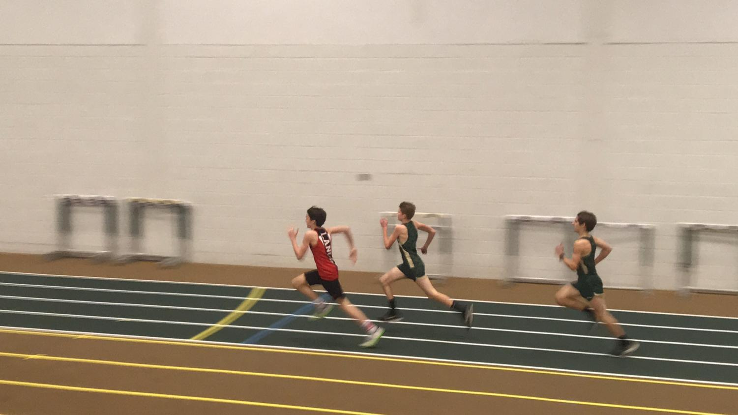 Freshman Brad Rose competes against two runners from Century High School in the 800 meter run.