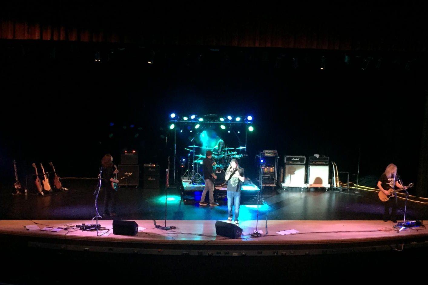 Nicholas Pare, Bob Pare, Alec Barnhart, Jeff Barnhart, and Kyle Stuhler perform at the concert.