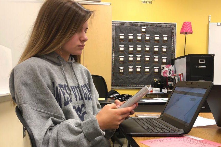 Melanie Linsdey works hard to finish her geometry homework.