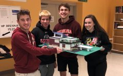 Catie Jo Tansey, Nick Hayslett, Colin Choudhary, and Alec Deyaert showcase their model.