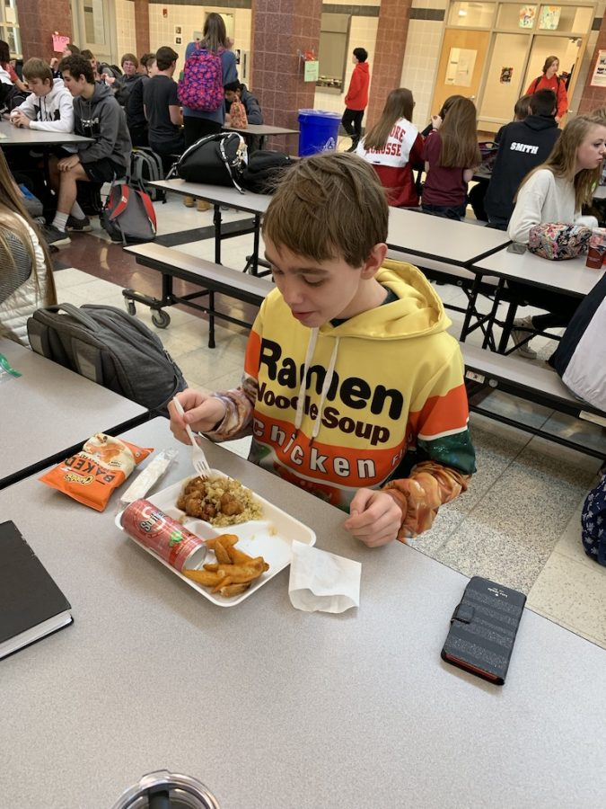 Kevin Aquino eats a cafeteria lunch.
