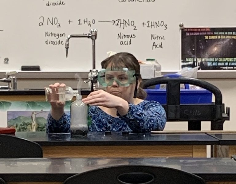 Mrs.McCauley makes hydrogen by pouring hydrochloric acid over zinc.