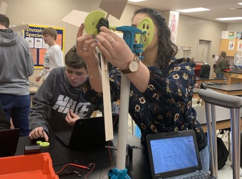 Mandi Feinberg visited from BNBI and helped student Ryan Orr build a windmill.