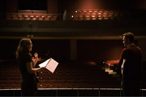 Lincoln Robisch and his assistant director Laura Gede block out a scene on stage.