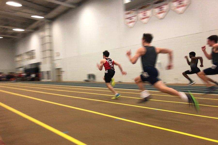 Senior Joey Felton blows past his competitors to win the 55-meter dash.