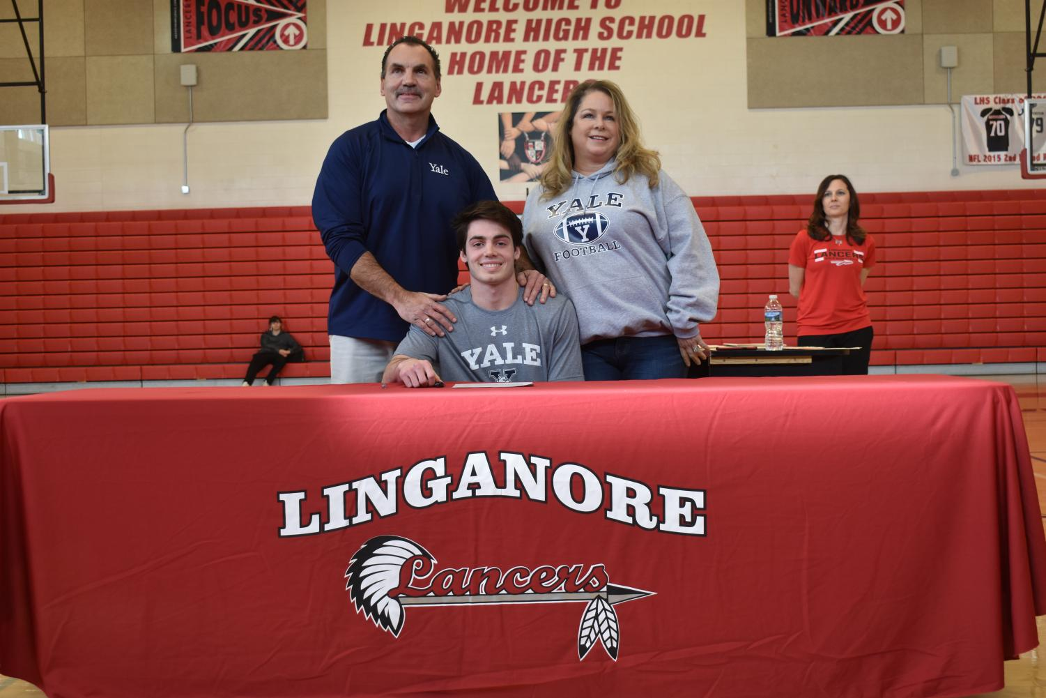 The Felton family smiles for the cameras as Joey makes commitment to Yale.