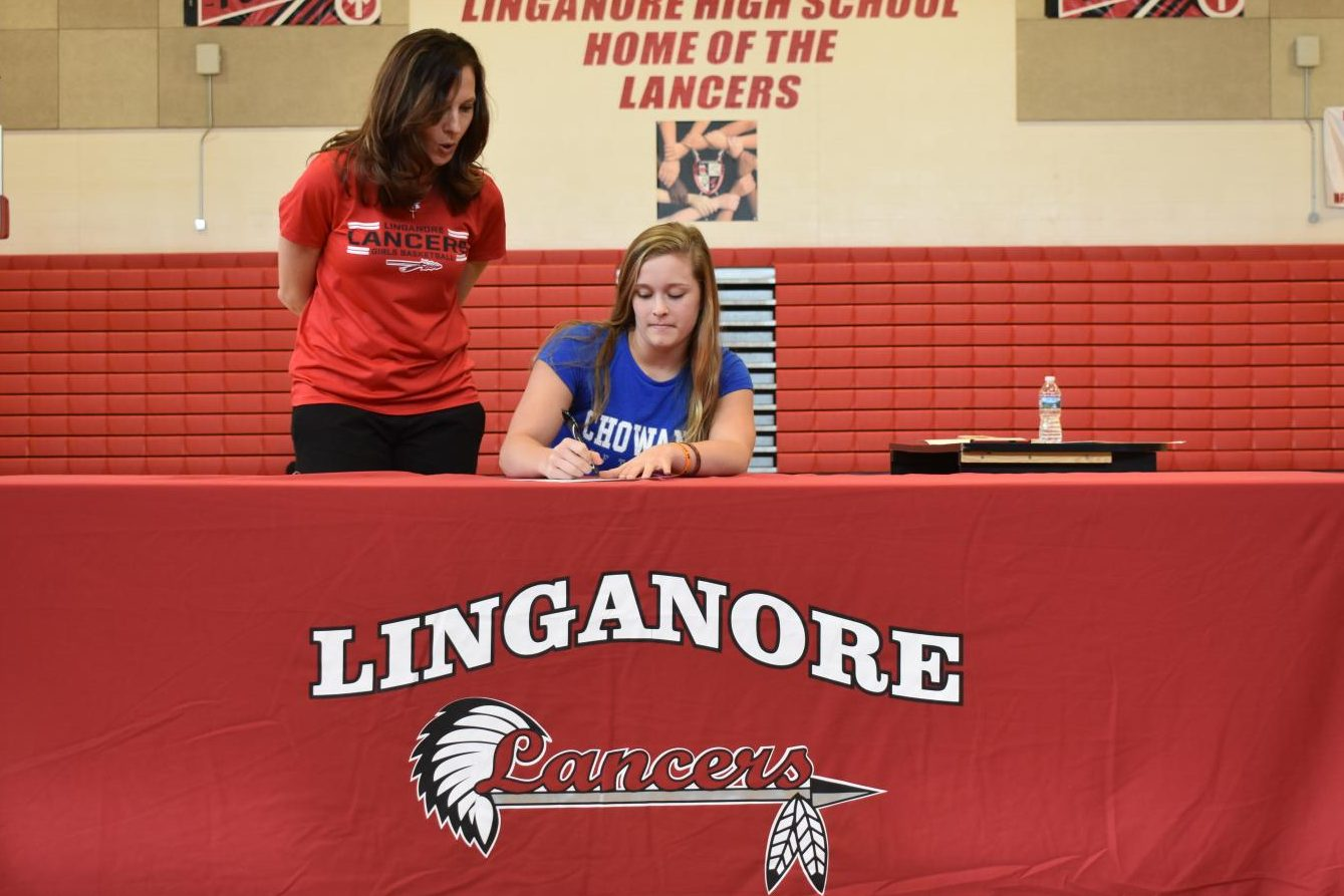 Paige Wilhelm signs her National Letter of Intent for Chowan University softball.