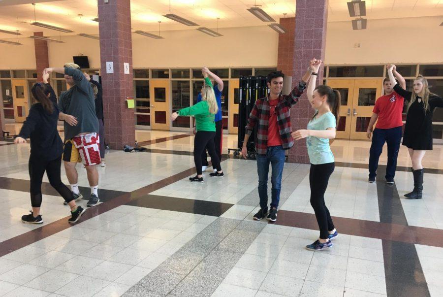Morgan Fink, Kayla Curran,  Alex Ismael, Eilis McCormick,  Matthew Gelhard, Emily Byrnes, Ryan McFadden and Riley Kidwell learn to ballroom dance.