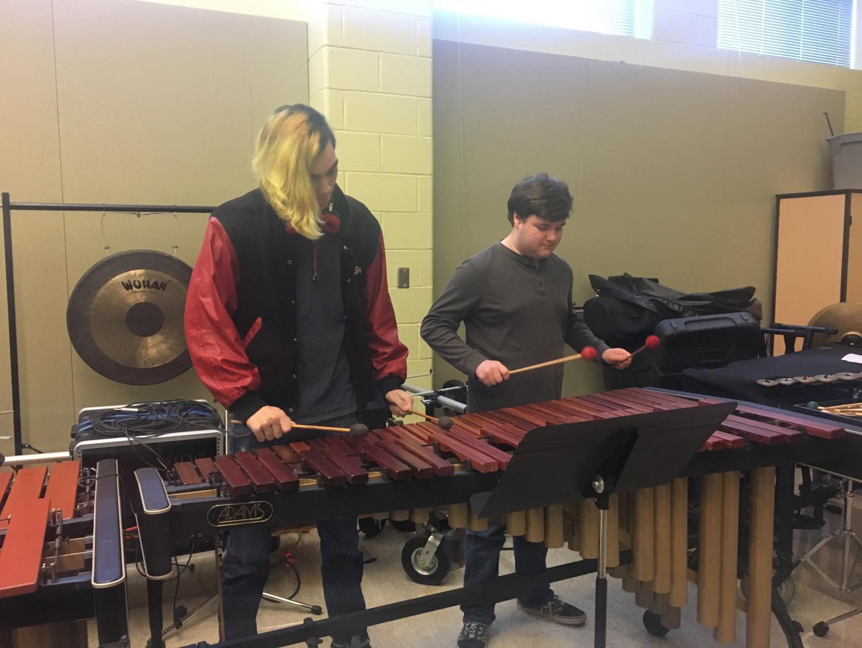 Ricky Guariglia and Anthony Proper play the marimba.