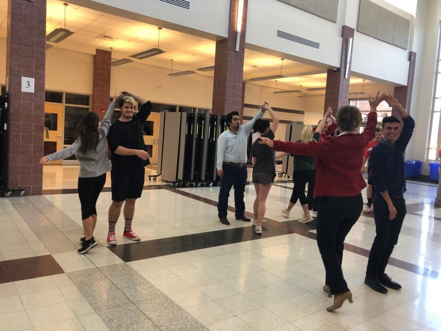 Mr. Linganore contestants and their escorts learn the merengue at dance practice.