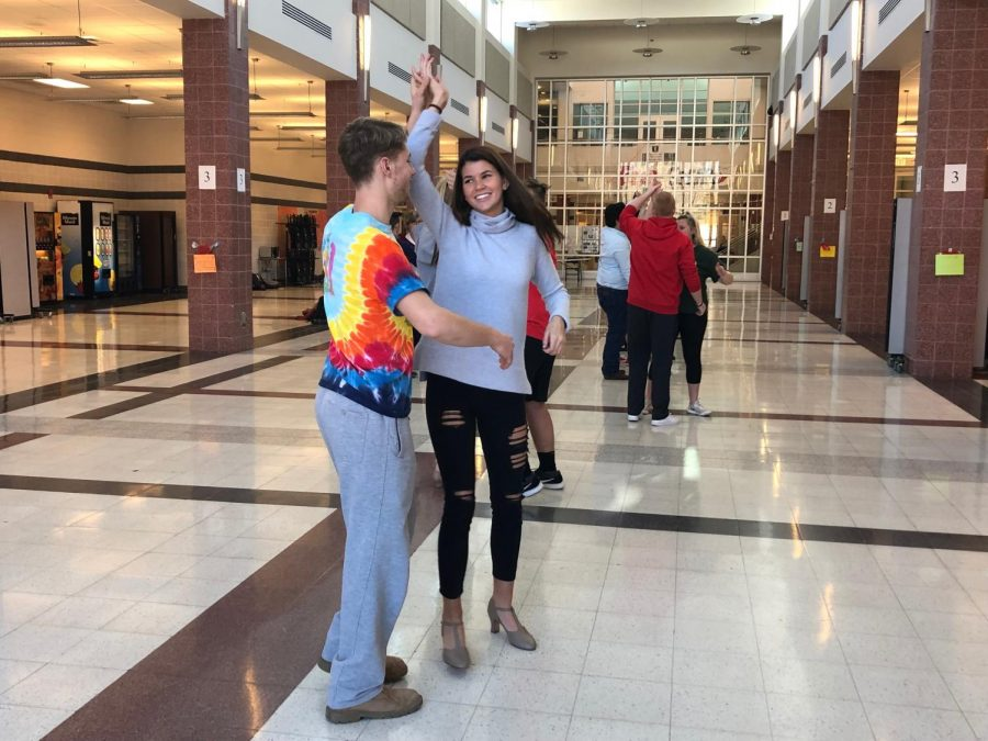 Jake Santis dances with Emily Wolfe during the merengue. They spent just as much time laughing at themselves as they danced.