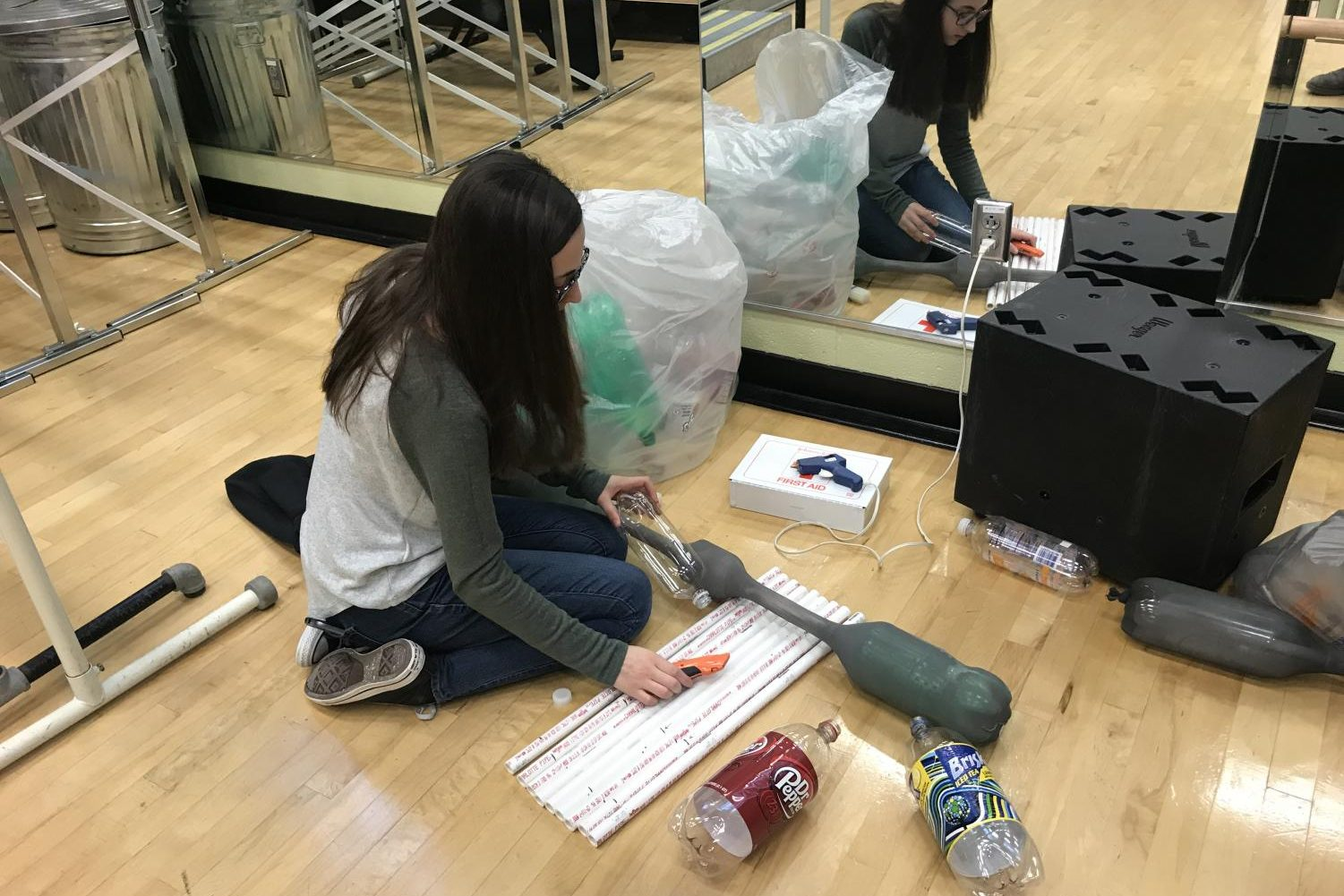 Kate Stadter builds props for the set.