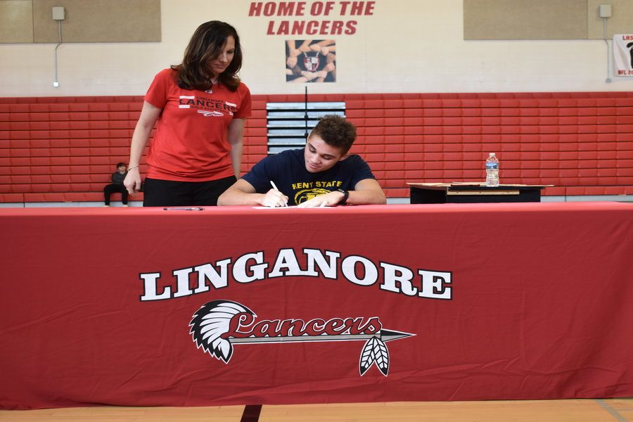 Earl Blake signs his National Letter of Intent to wrestle at Kent State University.