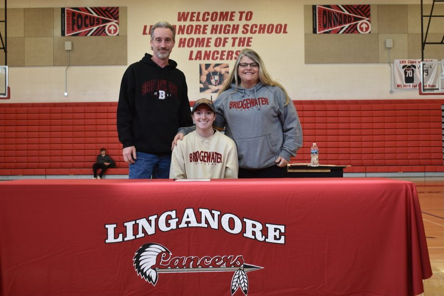 Sam Everett poses with family after officially signing to play softball for Bridgewater college.