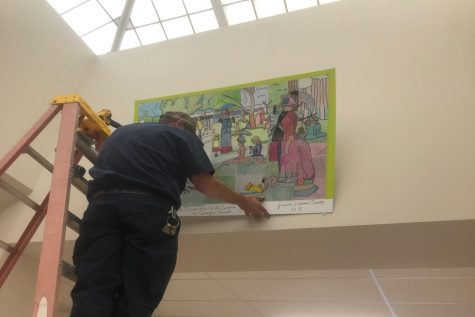 French Honor Society hangs Seurat mural: Photo of the Day 2/23/19