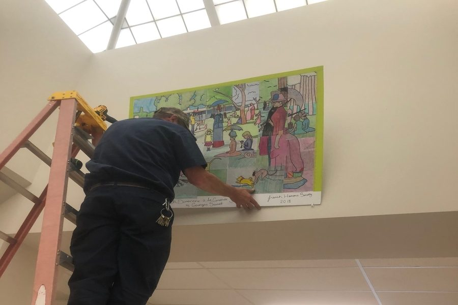 The completed Seurat mural was hung by a FCPS maintenance employee in the C hallway near the language classrooms.