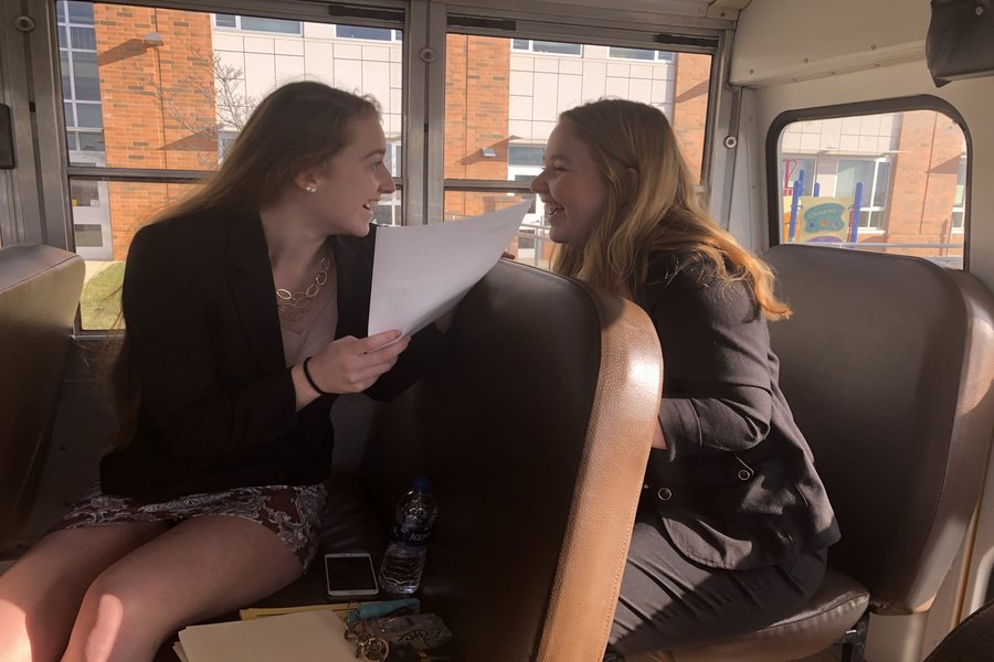 Class of 2019 members Sam Everett and MaKenzie Llewellyn prepare on the way to compete against Middletown for their fourth competition.