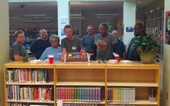 Custodians: Staff members thank custodians with cake!