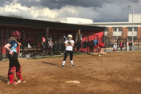 Class of 2021 member Darbe Reesman steps up to the plate to practice hitting in a game situation while class of 2021 member Alex Dembeck practices catching.