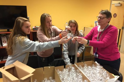 Taylor Ferguson, Meghan Mong-Kerwin, Alexis Fowler, and Paula Larson work on centerpieces for prom.