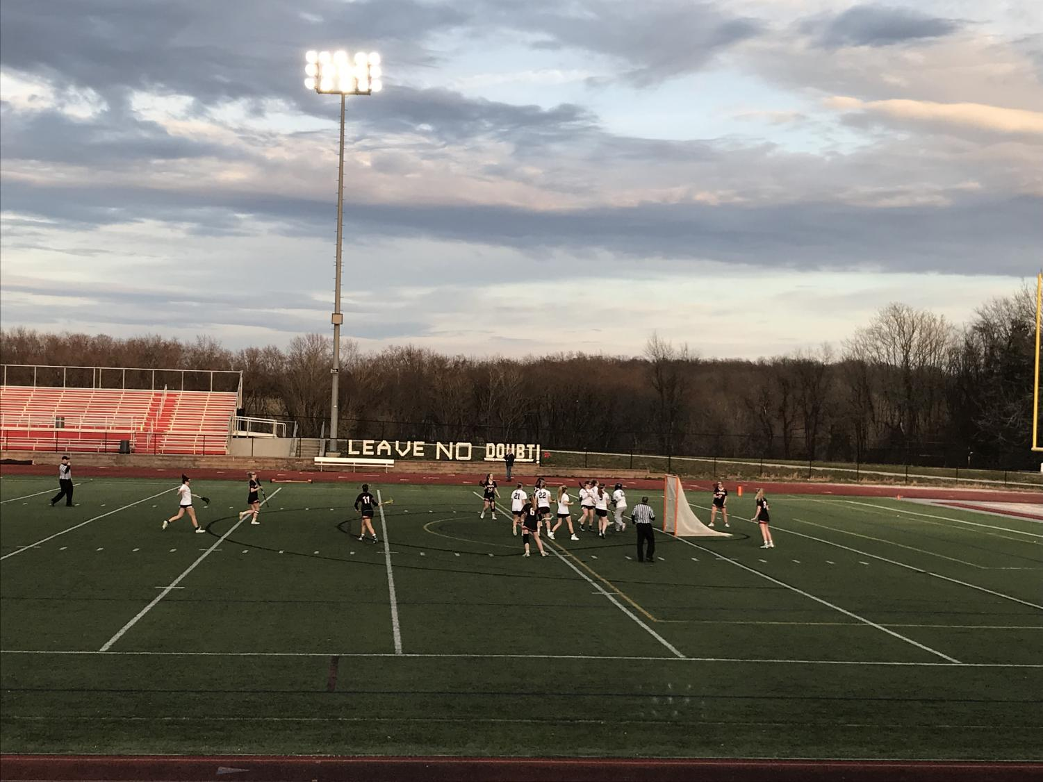 The Girls Varsity Lacrosse warms up before their game.