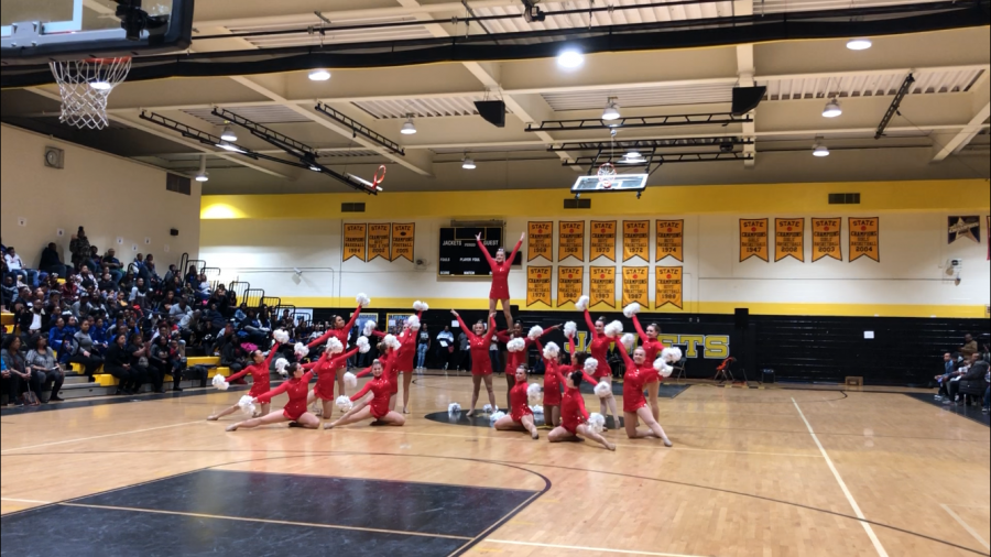 Pom team performs their Total Package dance.