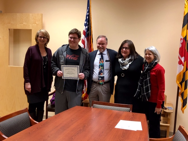 Matthew Strahlman was surprised with the Frederick Co. NEHS Common Reader Scholarship. Scott and Theresa Strahlman, Nancy Doll and other administrators and well-wishers attended the ceremony.