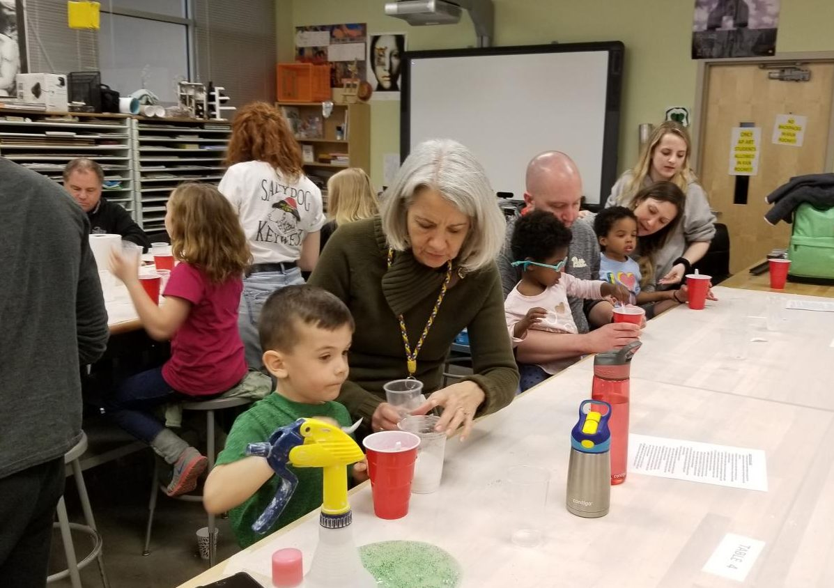 Principal Nancy Doll helps elementary school students make slime with NEHS.