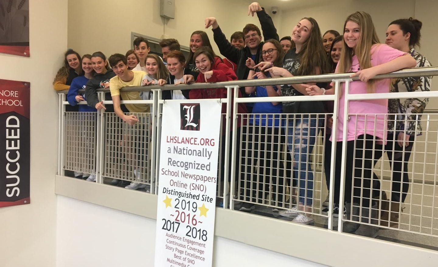 The Lancer Media team celebrates their fourth consecutive year being a SNO Distinguished Site.