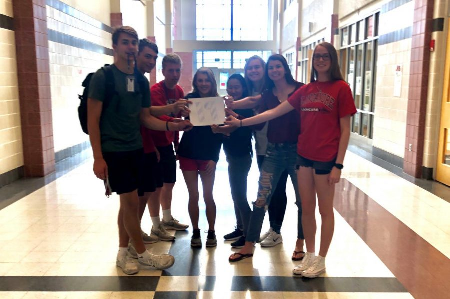 Senior SGA leaders Alec Deyaert, Charlie Rasmussen, Dominic Barbagallo, Shay Arneson, Erika Katsumoto, Jane Quackenbush, Emily Wolfe, and Caitlin Peigh pose for 19 days left of school.
