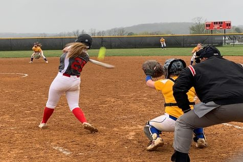 Class of 2022 Claire Thomas hits a foul ball during varsity softball's game against Walkersville.
