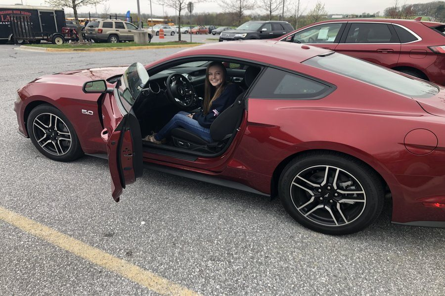 Brooke Bennett test drives a Mustang at Drive 4 UR School.