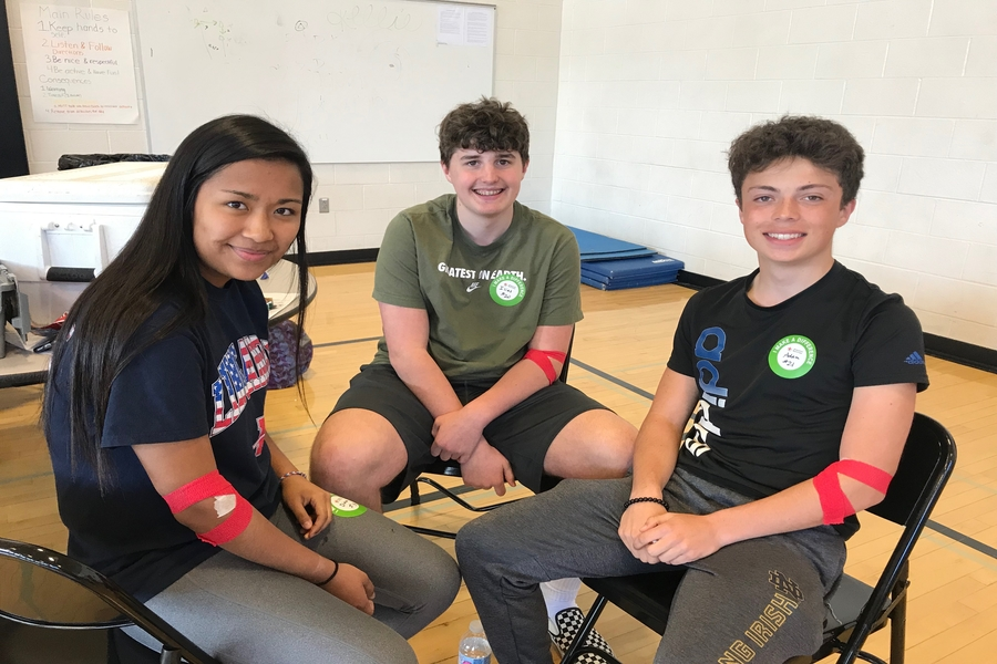 Sophomores Diana Bryan, Ilias Smith, and Adam Liston relax by the canteen area after donating blood.